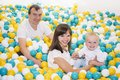 Young family in child room. Childhood memories. Royalty Free Stock Photo