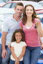 Young family collecting new car Royalty Free Stock Image