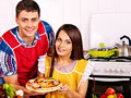 Young family cooking pizza at kitchen happy Stock Images