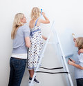 Young Family decorating their new home Royalty Free Stock Photo