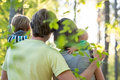 Young family enjoying a beautiful sunny day outdoors in a green Royalty Free Stock Photo