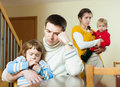 Young family of four having quarrel at home Stock Photography