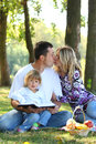 Young family having a picnic in nature Royalty Free Stock Photos