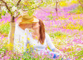 Young family kissing in garden cute sitting down on pink floral meadow the and women and men enjoying each other outdoors romance Royalty Free Stock Image