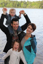 Young family at the lake Royalty Free Stock Photo