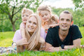 Young family lying on grass in countryside Royalty Free Stock Photo