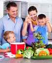 Young family making dinner together in the kitchen Royalty Free Stock Photo