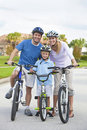 Young Family Parents and Boy Son Cycling Stock Photos
