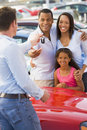 Young family picking up new car Stock Photography