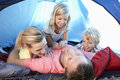 Young family playing in tent Royalty Free Stock Photography