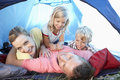 Young family playing in tent Royalty Free Stock Image