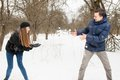 The young family plays winter wood on snow
