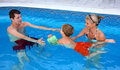 Young family in the pool Royalty Free Stock Photo