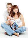 Young family portrait, smiling father mother and baby son Royalty Free Stock Photo