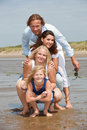 Young family by the seaside Stock Image