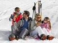 Young Family Sharing A Picnic On Ski Vacation Royalty Free Stock Photos