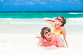 Young family sittin on beach and having fun caribbean Royalty Free Stock Images