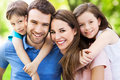 Young family smiling happy together outdoors Royalty Free Stock Image