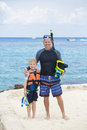 Young Family Snorkeling together in the Ocean Royalty Free Stock Photo