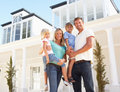 Young Family Standing Outside Dream Home Royalty Free Stock Photography