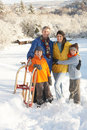 Young Family Standing In Snowy Landscape Stock Photography
