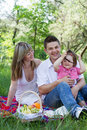 Young family of three on a picnic Royalty Free Stock Photography
