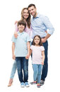 Young family with two children standing together Royalty Free Stock Photo