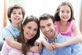 Young family with two kids smiling relaxing at home Royalty Free Stock Photography