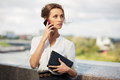 Young fashion business woman calling on mobile phone Royalty Free Stock Photo