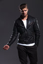 Young fashion male model in leather jacket posing Royalty Free Stock Photo