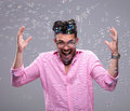 Young fashion man goes crazy among bubbles going while fly around him on a white background Stock Images
