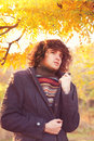 Young fashion man portrait dressed in gray jacket and striped sweater oudoor in autumn park adult Stock Images