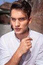 Young fashion man posing near a brick wall. Royalty Free Stock Photo