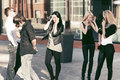 Young fashion people calling on mobile phones Royalty Free Stock Photo