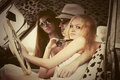 Young fashion people driving vintage car Royalty Free Stock Photo