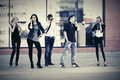 Young fashion people talking on cell phones in city street Royalty Free Stock Photo