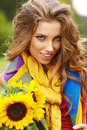 Young fashion woman with a bouquet of sunflowers Royalty Free Stock Photo