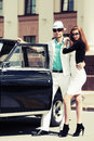 Young fashionable couple at the retro car in love Royalty Free Stock Photo