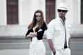 Young fashionable couple walking city street Royalty Free Stock Image