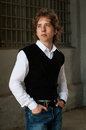 Young fashionable man in black vest Royalty Free Stock Photo