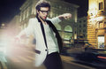 Young fashionable man on the street at night Royalty Free Stock Photography