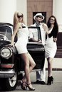 Young fashionable people at the retro car men and women Royalty Free Stock Image