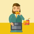 Young fat guy eating while at work Royalty Free Stock Photo