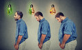 Young fat man becoming slim guy Royalty Free Stock Photo