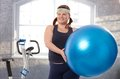 Young fat woman exercising with fit ball Royalty Free Stock Image