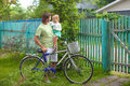 Young father and cute little daughter cycling around the farmhouse this image has attached release Stock Photo