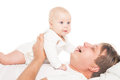 Young father is having fun with his little baby over white background Stock Photography