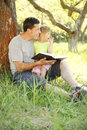 Young father with his little daughter reads the bible a Royalty Free Stock Photography