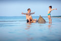Young father and his son having fun at beach Royalty Free Stock Photo