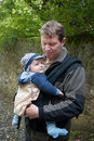 Young father and his son in rucksack Stock Images